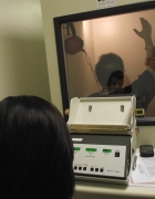Special Olympics athlete in hearing booth