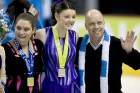 Scott Hamilton poses with gold and silver medal winners from figure skating at the 2009 Special Olympics World Winter Games in Boise, Idaho.