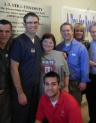 Devin Hohl poses with the dental team that provided her free services