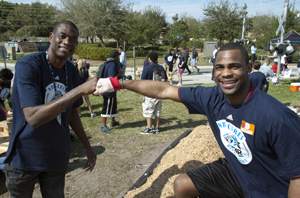 Special Olympics athlete Anthony Nunn (MN) works with NBA legend and longtime Special Olympics supporter Dikembe Mutombo at NBA Cares Day of Service in Orlando, FL