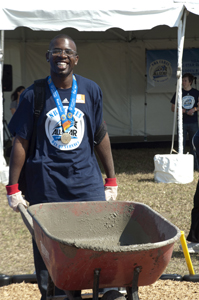Special Olympics athlete Robert Cooper shows off his gold medal from the 2011 Special Olympics World Summer Games as he assists in the 2012 NBA All-Star Day of Service