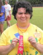 Virginia showing off her awards in Special Olympics Hawaii