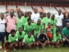 World-famous footballer Didier Drogba poses with athletes from Special Olympics Côte d'Ivoire
