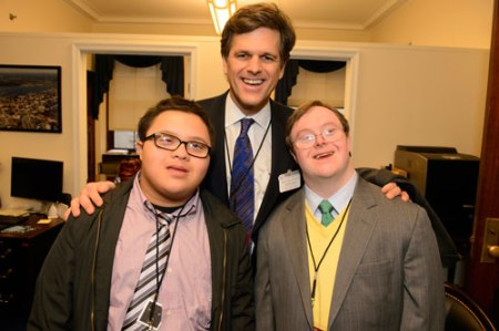 Special Olympics President and CEO Dr. Timothy Shriver with Special Olympics athlete John Franklin Stevens (r) and Best Buddies Ambassador Kevin Leon (l).