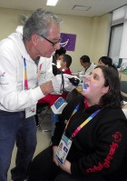 Dr. Steve Perlman conducts a health screening for Special Olympics Spain athlete Leyre Buigues during the 2013 Special Olympics World Winter Games.