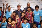 Messi and Pinto with athletes and partners from Special Olympics Thailand.