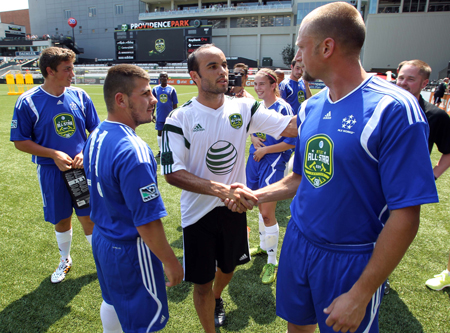 US soccer legend Donovan Landon takes time to meet athletes and partners before the match.