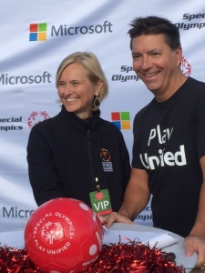 Special Olympics CEO Janet Froetscher, left, and Jeff Hansen, General Manager of Brand Studios for Microsoft Corporation celebrate the new partnership.