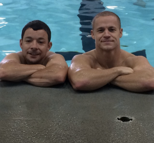 Tim (left) and Todd (right) Siler taking a break from swimming in 2014.