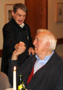 Jean Vanier shaking hands with one of the core members of L'Arche Daybreak, John Smeltzer.
