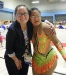 Gymnastics official Lani DeMello of Georgia, USA, with gymnast Melissa Escamilla of Mexico.